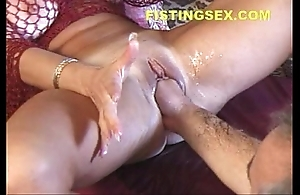 Gushing ty (fisting induces 2 squirting orgasms)